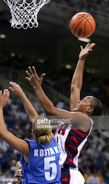 US Lisa Leslie tries to shoot despite Greece's Anastasia Kostaki in the women's basketball quarterfinals match 25 August 2004 at the Olympic indoor...