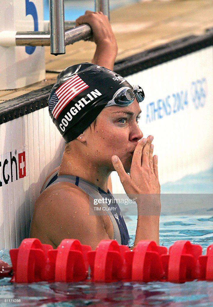 US Natalie Coughlin jubilates after winning the women's 100m backstroke semi-final 2 at the 2004 Olympic Games at the Olympic Aquatic Center in Athens, 15 August 2004.