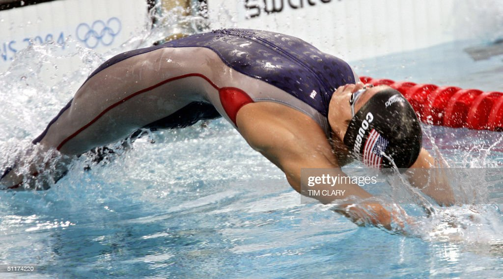 US Natalie Coughlin performs during the women's 100m backstroke semi-final 2 at the 2004 Olympic Games at the Olympic Aquatic Center in Athens, 15 August 2004.