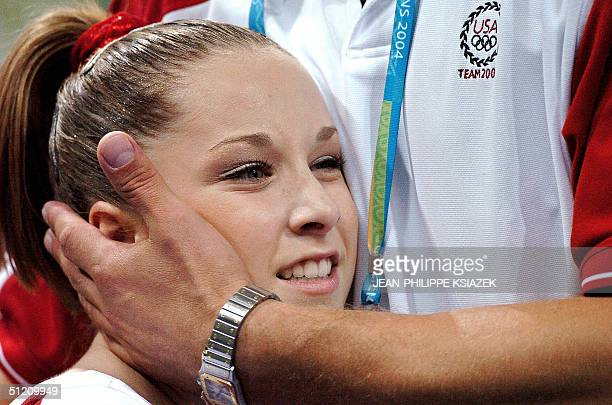 Silver medallist Carly Patterson celebrates after the women's beam final, 23 August 2004 at the Olympic Indoor Hall in Athens during the Olympics...