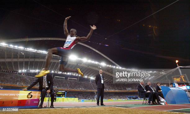 USA's Dwight Phillips competes in the men's long jump final at the Olympic Stadium 26 August 2004 during the Olympic Games athletics competitions in...