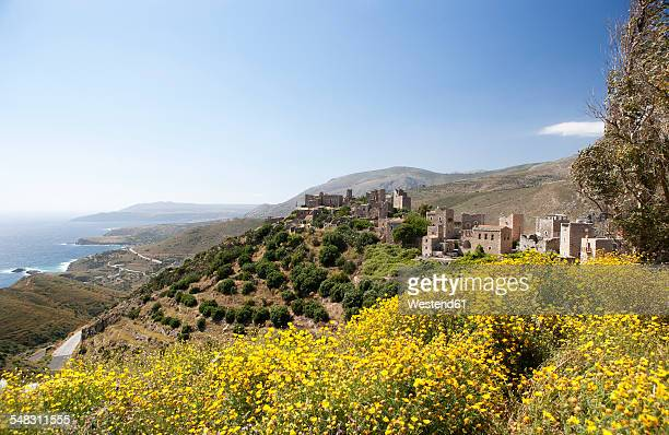 greece, vatheia, tower houses and coastal landscape - peloponnese stock photos and pictures
