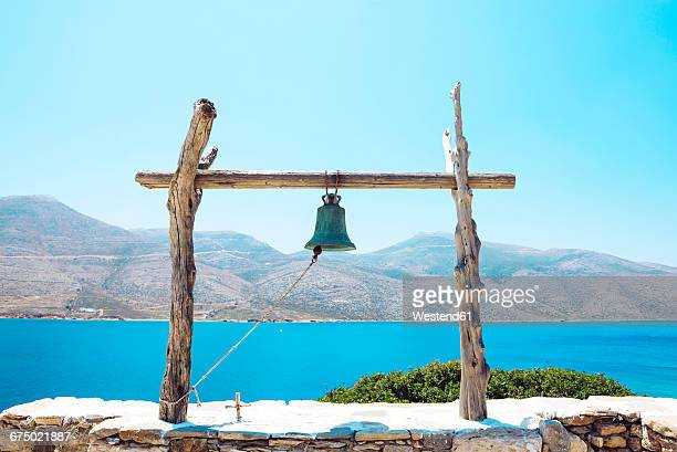 Greece, view from Nikouria to Amorgos with bell construction in the foreground