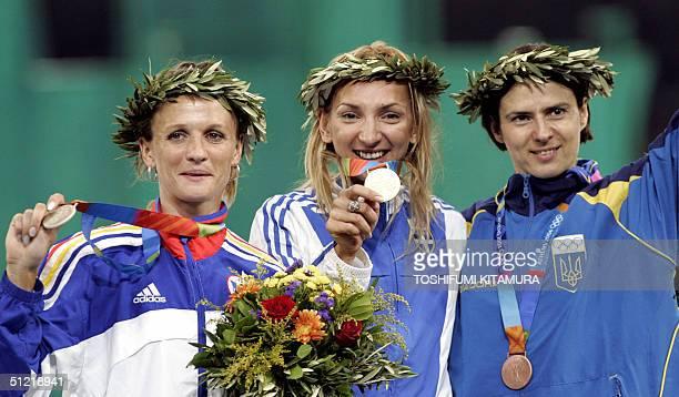 Women's 400m hurdles gold medal winner Fani Halkia of Greece poses on the podium with silver winner Ionela TirleaManolache of Romania and bronze...