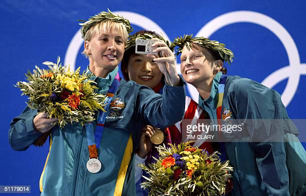 Xuejuan Luo from China gold medal Leisel Jones bronze medal and Brooke Hanson silver medal from Australia pose on the podium after winning women's...