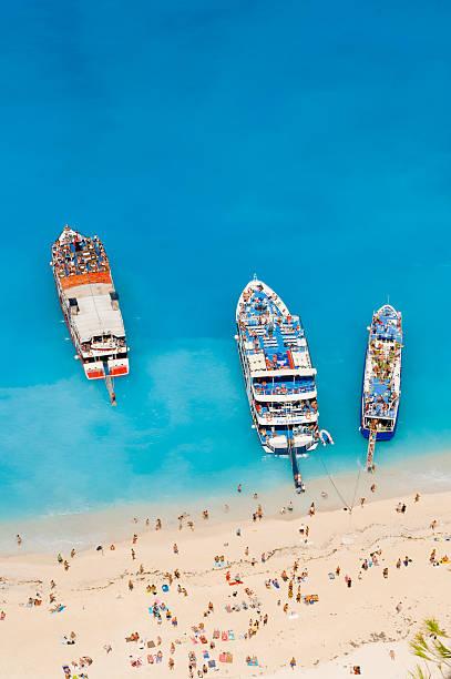 Greece, Zakynthos Island, aerial beach of people on beach and ships