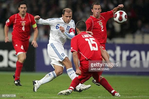 Greece's Aggelos Basinas scores against Malta during their Euro2008 qualification football game in Athens 17 November 2007 AFP PHOTO / Aris Messinis...