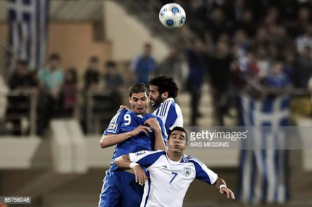 Greece's Angelos Charisteas fights for the ball with Israel's Biram Kayal during a Europe group 2 qualification football game for the 2010 World Cup...
