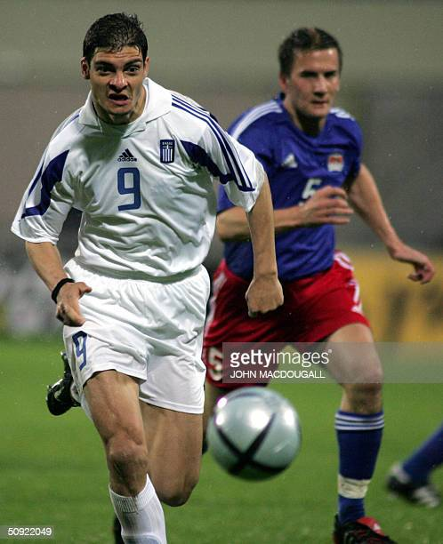 Greece's Angelos Charisteas vies for the ball against Liechtenstein's Christof Ritter during a preEuro2004 friendly match between Greece and...