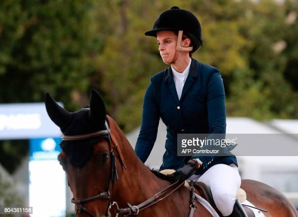 Greece's Athina Onassis riding MHS Going Global looks on during the Paris Eiffel Jumping event on June 30 2017 in Paris / AFP PHOTO / JACQUES...