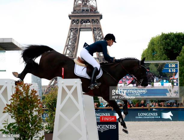 Greece's Athina Onassis riding Rackham'Jo competes in the Paris Eiffel Jumping event in Paris on June 30 2017 / AFP PHOTO / JACQUES DEMARTHON