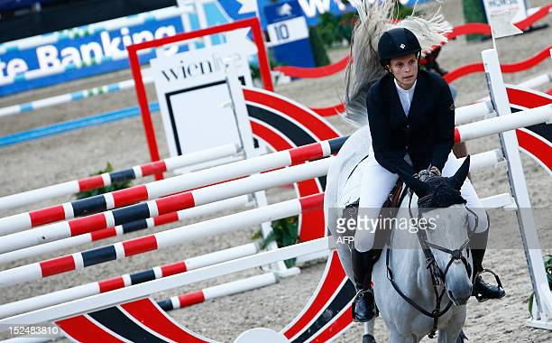 Greece's Athina OnassisDe Miranda rides AD Uceline as she competes in the 2012 Vienna Masters International jumping competition as part of the Global...