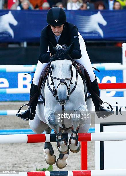 Greece's Athina OnassisDe Miranda rides 'AD Uceline' as she competes in the 2012 Vienna Masters International jumping competition as part of the...
