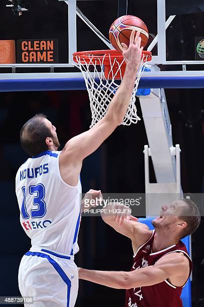 Greece's center Kostas Koufos goes to the basket during the classification basketball match between Greece and Latvia at the EuroBasket 2015 in Lille...