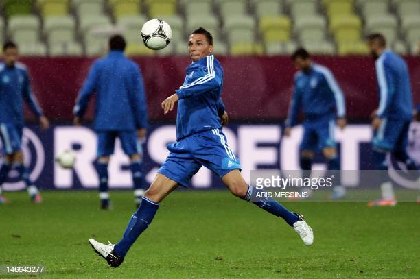 Greece's defender Jose Holebas eyes the ball during a training session at the PGE Arena in Gdansk on June 21, 2012. Greece will face Germany in the...