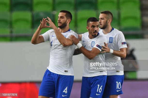 Greece's defender Kostas Manolas celebrates scoring during the Nations League football match between Hungary and Greece on September 11 in Budapest,...