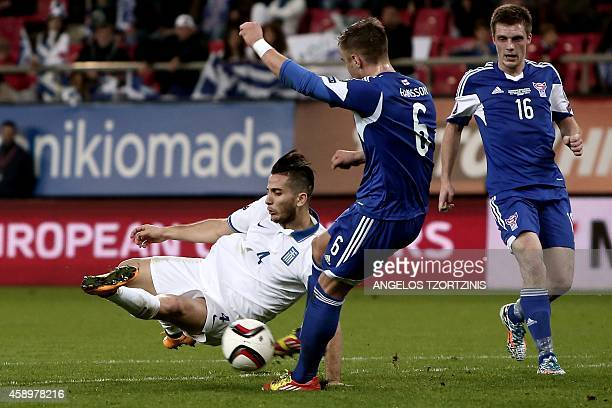 Greece's defender Kostas Manolas vies for the ball with Faroe Island's midfielder Hallur Hansson during the UEFA Euro 2016 group F qualifying...
