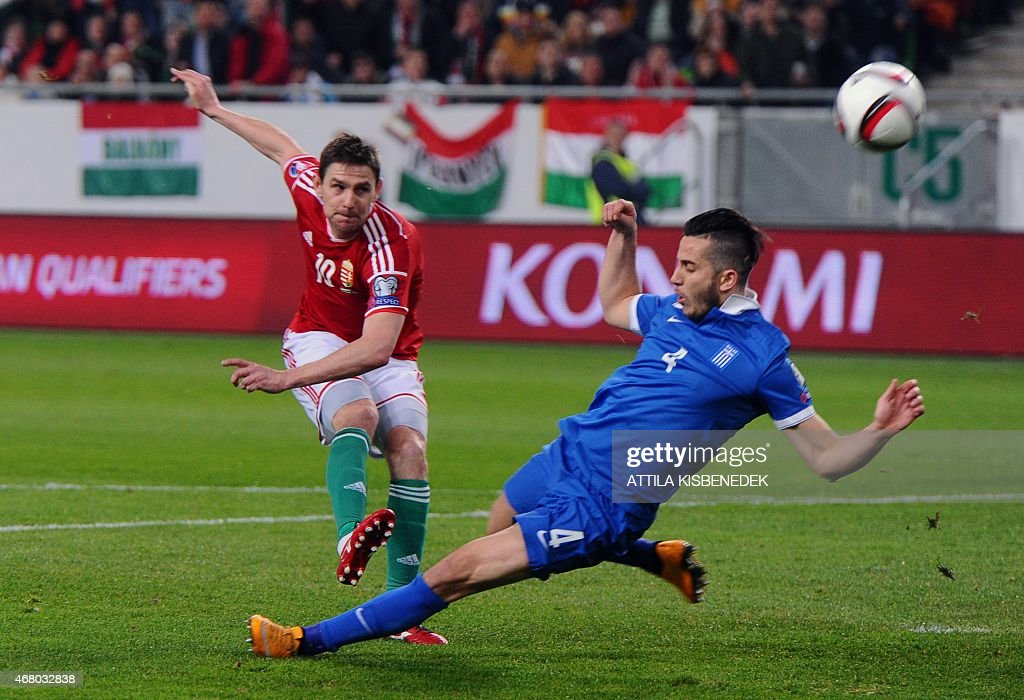 Greece's defender Kostas Manolas (R) vies with Hungary's midfielder Zoltan Gera during the Euro 2016 qualifying football match between Hungary and Greece at the Groupama Arena in Budapest on March 29, 2015.