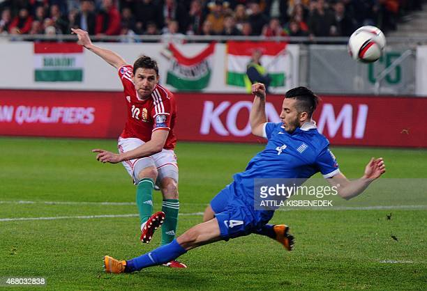 Greece's defender Kostas Manolas vies with Hungary's midfielder Zoltan Gera during the Euro 2016 qualifying football match between Hungary and Greece...