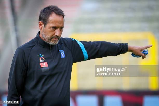Greece's Dutch-Canadian head coach John Van'T Schip gestures during a training session of Greece national football team in Brussels on June 2, 2021...