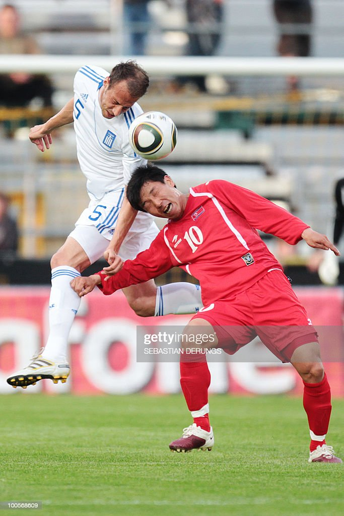 Greece's Evangelos Moras (L) heads for the ball with North Korea's Yong Jo Hong during a friendly football game, in Altach on May 25, 2010 ahead of their participation to the FIFA World Cup 2010 in South Africa.
