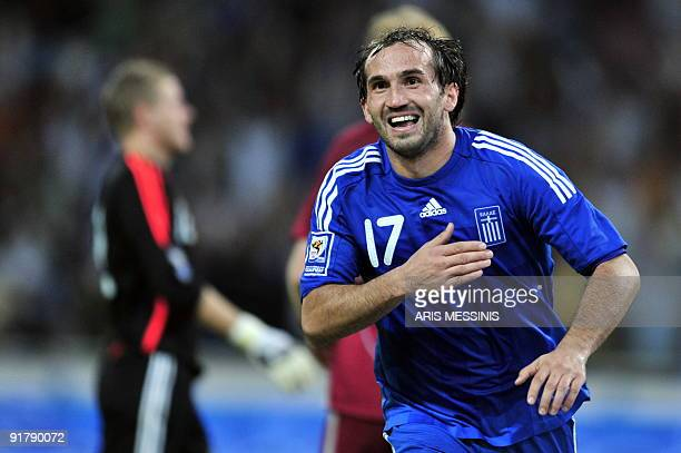 Greece's Fanis Gekas celebrates after scoring against Latvia during their 2010 World Cup qualification football game at the Athens Olympic staium on...