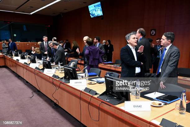 Greece's Finance Minister Euclid Tsakalotos and Ireland's Finance Minister Paschal Donohoe attend a Eurogroup meeting at the European Council in...