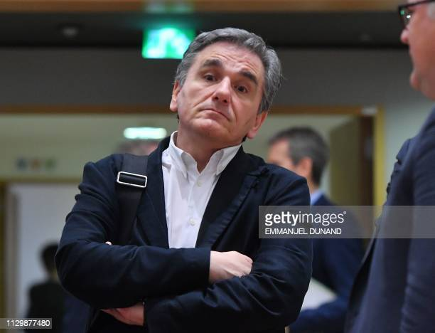 Greece's Finance Minister Euclid Tsakalotos attends a Eurogroup finance minister's meeting at the European Council in Brussels on March 11 2019