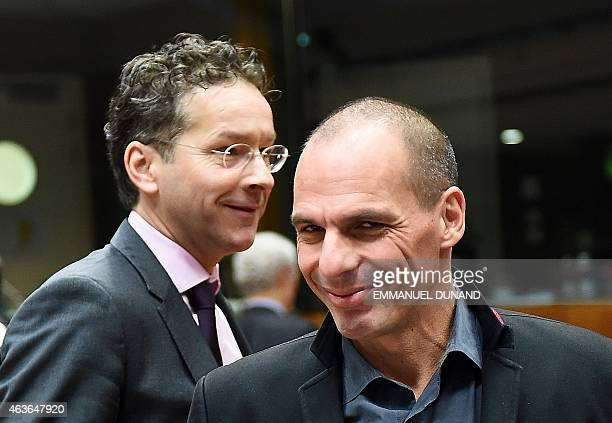 Greece's Finance Minister Yanis Varoufakis and Eurogroup President and Dutch Finance Minister Jeroen Dijsselbloem arrive to take part in a European...
