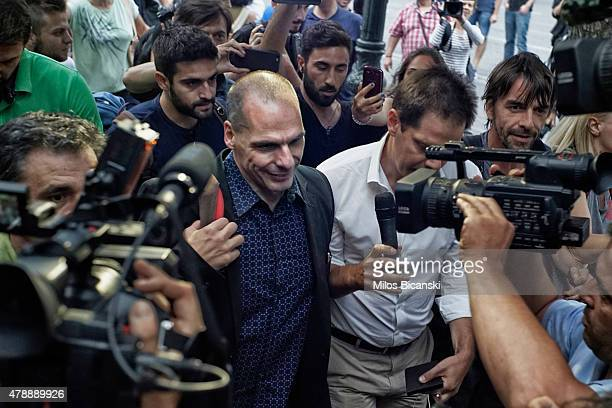 Greece's Finance Minister Yanis Varoufakis center arrive for an urgent cabinet meeting at Maximos Mansion on June 28 2015 in Athens Greece Greece has...