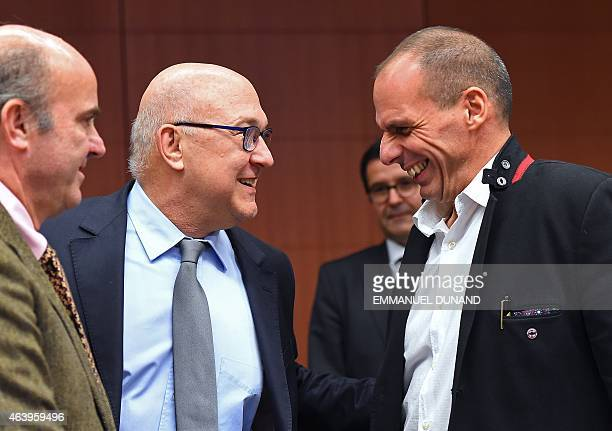 Greece's Finance Minister Yanis Varoufakis speaks with French Finance Minister Michel Sapin and Spanish Finance Minister Luis de Guindos Jurado...