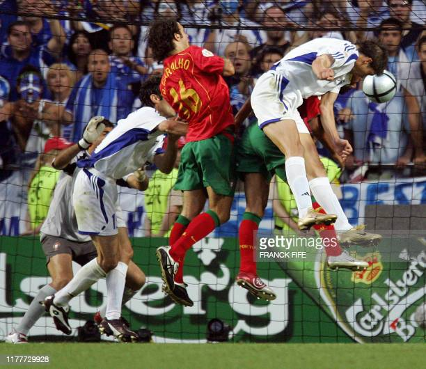 Greece's forward Angelos Charisteas heads the ball in to score against Portugal, 04 July 2004 at the Luz stadium in Lisbon, during the Euro 2004...