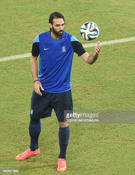 Greece's forward Georgios Samaras attends a team training session at the Dunas Arena in Natal on June 18 one day before their Group C 2014 FIFA World...