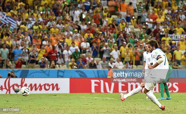 Greece's forward Georgios Samaras takes a penalty kick during the Group C football match between Greece and Ivory Coast at the Castelao Stadium in...
