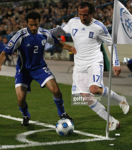 Greece�s forward Theofanis Gekas vies for the ball with Israel�s defender Klemi Saban during their European 2010 World Cup qualifying match at the...