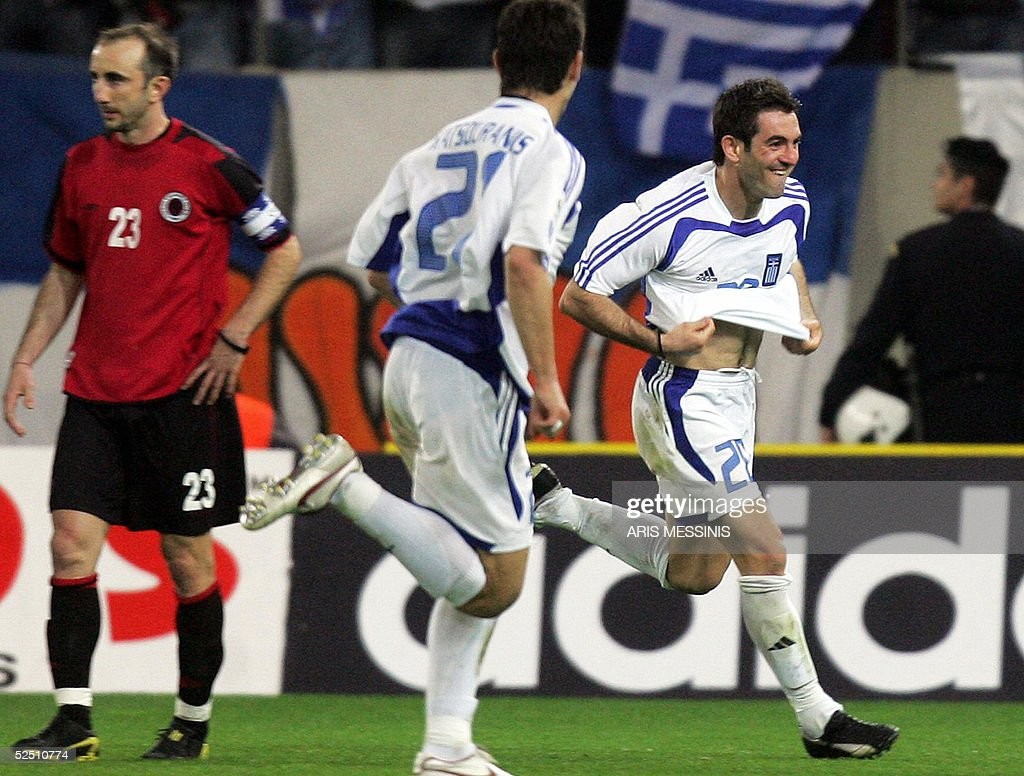 Greece's George Karagounis (R) jubilates after scoring a goal against Albania during their 2006 World Cup qualification football match, 30 March 2005 in Athens. Greece won 2-0. AFP PHOTO Aris MESSINIS