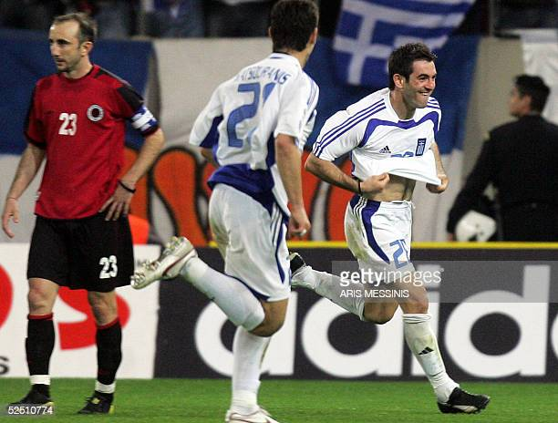 Greece's George Karagounis jubilates after scoring a goal against Albania during their 2006 World Cup qualification football match 30 March 2005 in...