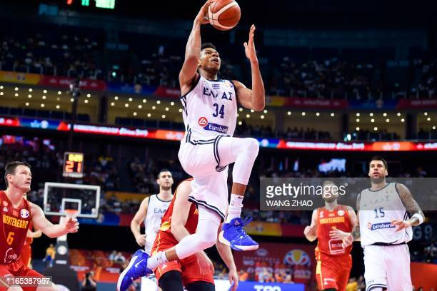 Greece's Giannis Antetokounmpo takes a shot during the Basketball World Cup Group F game between Greece and Montenegro in Nanjing on September 1,...