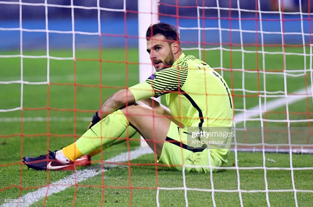 Greece's goalkeeper Orestis Karnezis sits on the football pitch after recieving a goal during the WC 2018 play-off football qualification match between Croatia and Greece at the Maksimir stadium, in Zagreb, on November 9, 2017. /