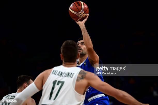 Greece's guard Kostas Sloukas throws the ball to the basket next to Lithuania's Jonas Valanciunas during the FIBA Eurobasket 2017 men's round 16...