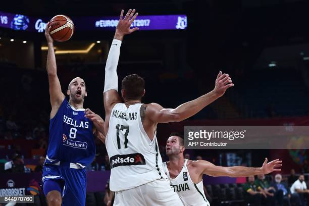 TOPSHOT Greece's guard Nick Calathes vies for the ball with Lithuania's center Jonas Valanciunas and Mantas Kalnieis during the FIBA Eurobasket 2017...