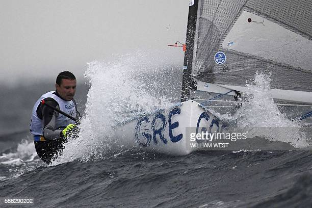 Greece's Ioannis Mitakis competes in the Finn Men sailing class on Marina da Gloria in Rio de Janerio during the Rio 2016 Olympic Games on August 10...