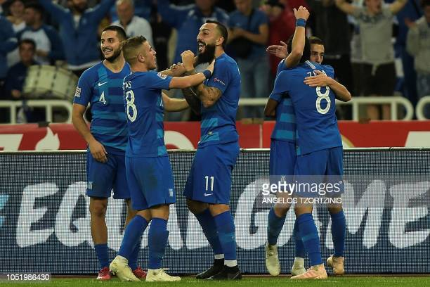 Greece's Kostas Mitroglou celebrates with his teammates after scoring a goal during the UEFA Nations League football match between Greece and Hungary...