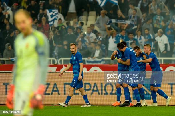 Greece's Kostas Mitroglou celebrates with his teammates after scoring against Hungary during the UEFA Nations League football match between Greece...