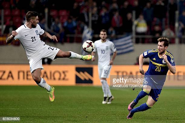 Greece's Kostas Stafylidis tries to control the ball during the 2018 World Cup football qualification match between Greece and Bosnia and Herzegovina...