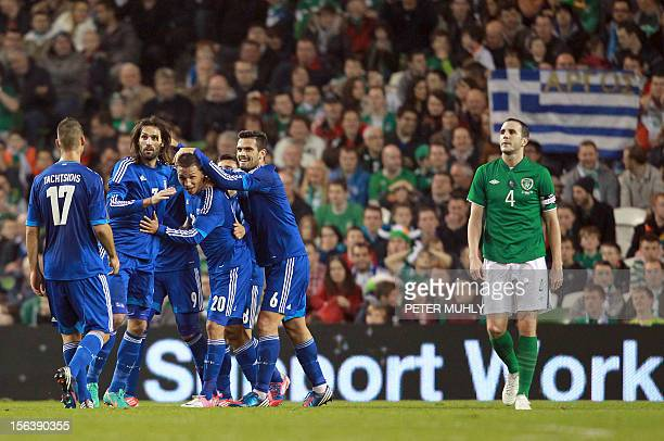 Greece's Loint Cholevas celebrates with teammates after scoring against the Republic of Ireland during their FIFA World Cup 2014 friendly football...