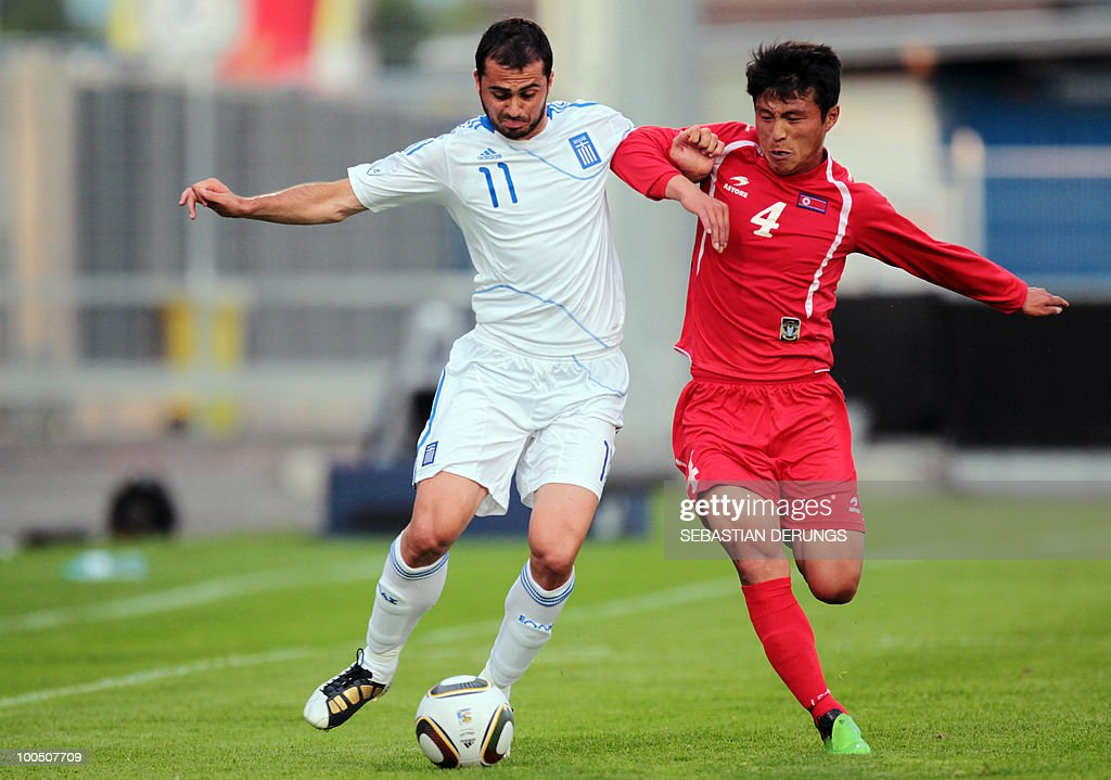 Greece's Loukas Vyntra (L) vies for the ball with North Korea's Nam Chol Pak during a friendly football game, in Altach on May 25, 2010 ahead of their participation to the FIFA World Cup 2010 in South Africa.