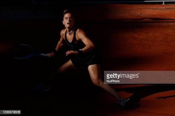 Greece's Maria Sakkari returns the ball to Czech Republic's Barbora Krejcikova during their women's singles semi-final tennis match on Day 12 of The...