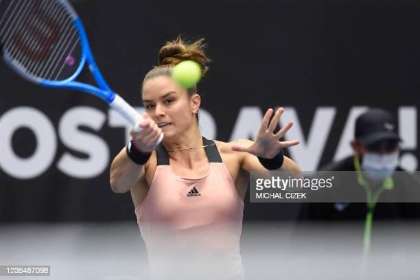 Greece's Maria Sakkari returns the ball to Poland's Iga Swiatek during their women's singles semi-final match of the Ostrava Open WTA tennis...
