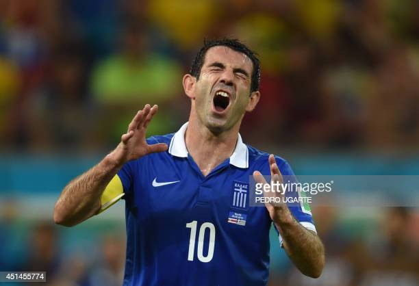 Greece's midfielder and captain Giorgos Karagounis reacts during a Round of 16 football match between Costa Rica and Greece at Pernambuco Arena in...